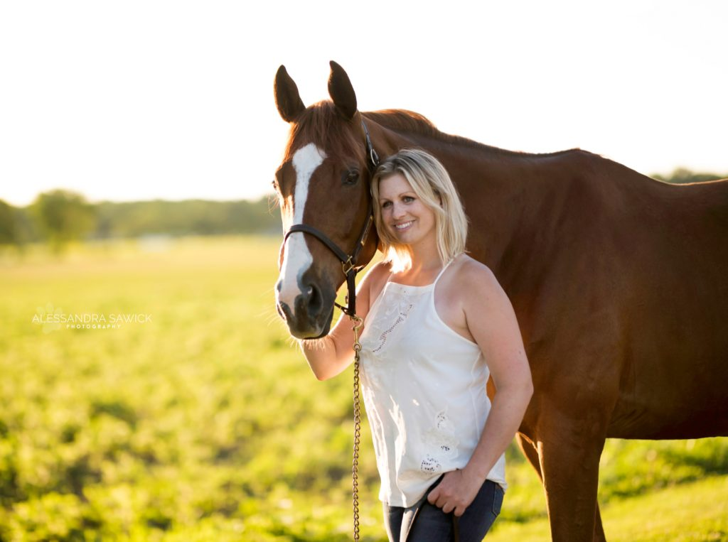 Photo of smiling woman with her horse in New Jersey